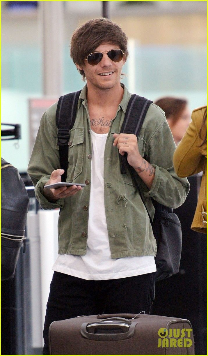 Louis tomlinson lets his hair down in manchester after splitting from - Louis Tomlinson Danielle Campbell Depart Heathrow After Attending Friends Wedding Photo Louis Tomlinson And Girlfriend Danielle Campbell Are All Smiles