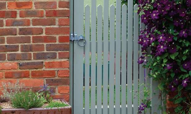 a cottage garden with a contemporary edge gate colour. Black Bedroom Furniture Sets. Home Design Ideas