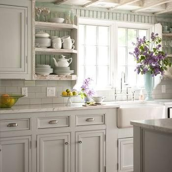 cottage kitchen with white beadboard cabinets and sea glass green
