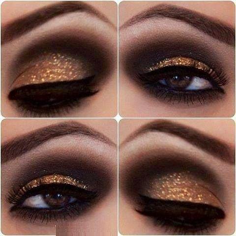 A dramatic eye makeup in bronze & black.