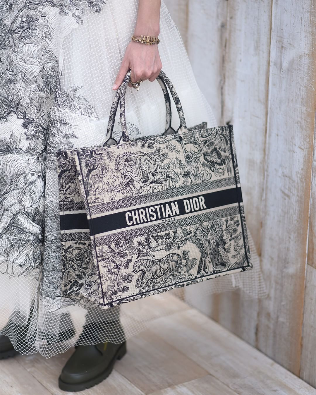 f686ca75e6a The revamped toile de Jouy makes its way onto our newly-iconic 'Book Tote'  for Cruise 2019, with the medley of wild animals that…