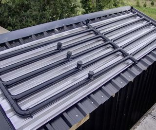 Automated Solar Hot Water Power Shower Using Black Plastic Pipes Power Shower Solar Hot Water Solar Hot Water Heater