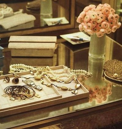 Something about jewelry laid out like this just looks so fab and rich.  I want a giant vanity when I have my own house!