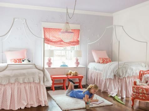 PB Teen canopy beds, coral with soft pink palette, and ikat Quadrille upholstered chair