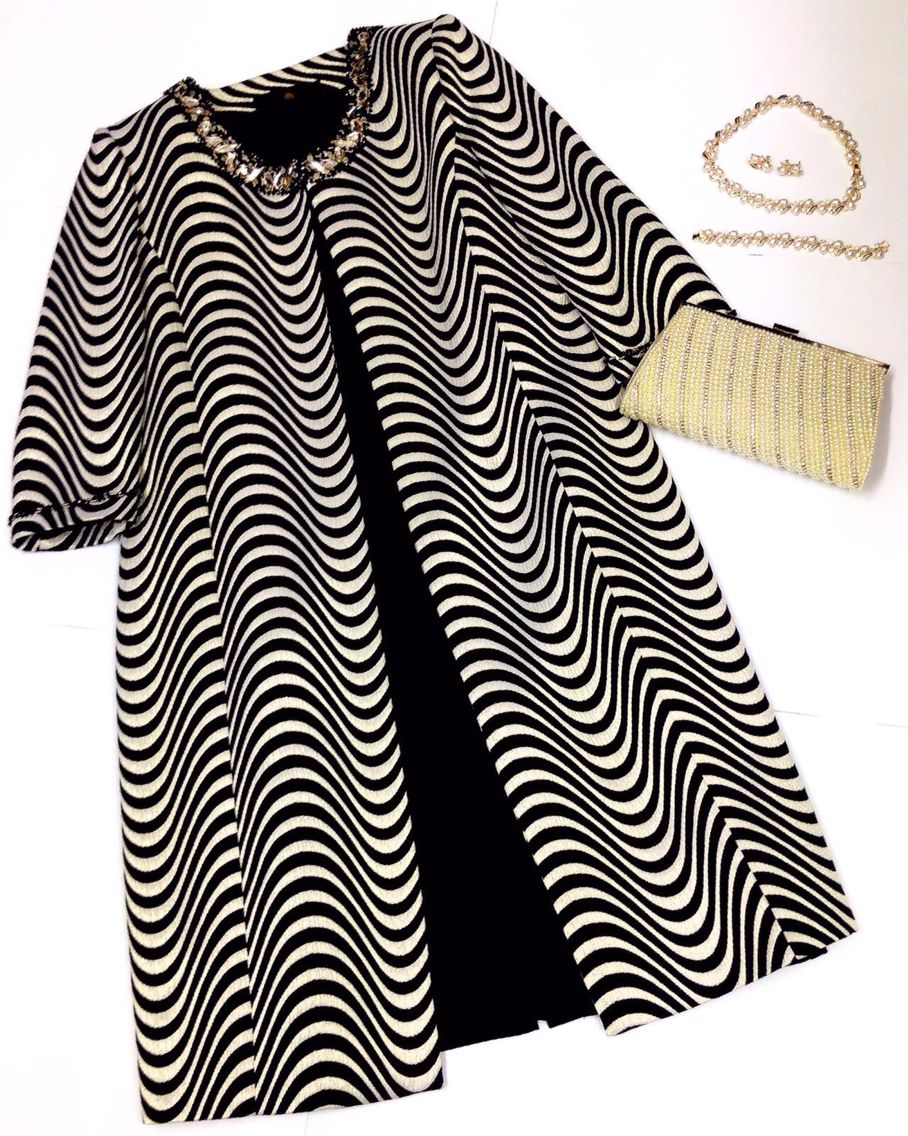 Blackgold dress with long jacket matched with cream pearl
