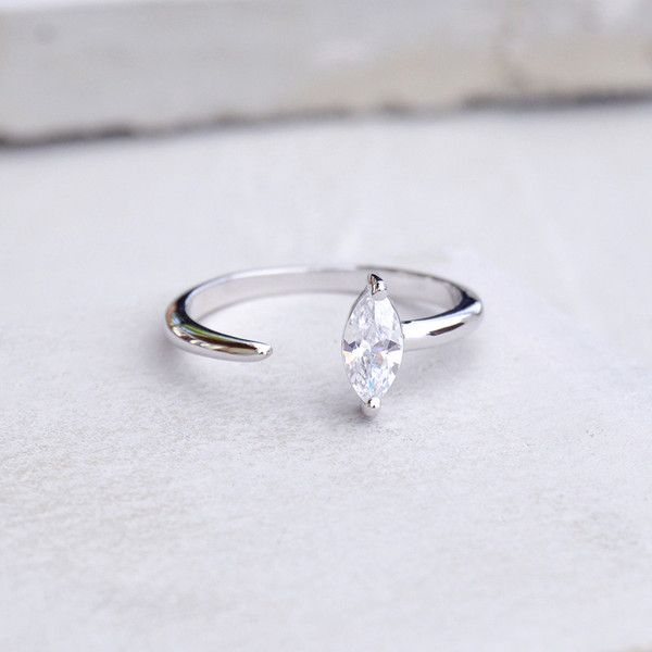 This delicate marquis ring looks great stacked or on its own. The ring features a super shiny marquis stone with a pointed band wrapping around the finger. Rhodium Plated Brass Ring with White CZ Diam