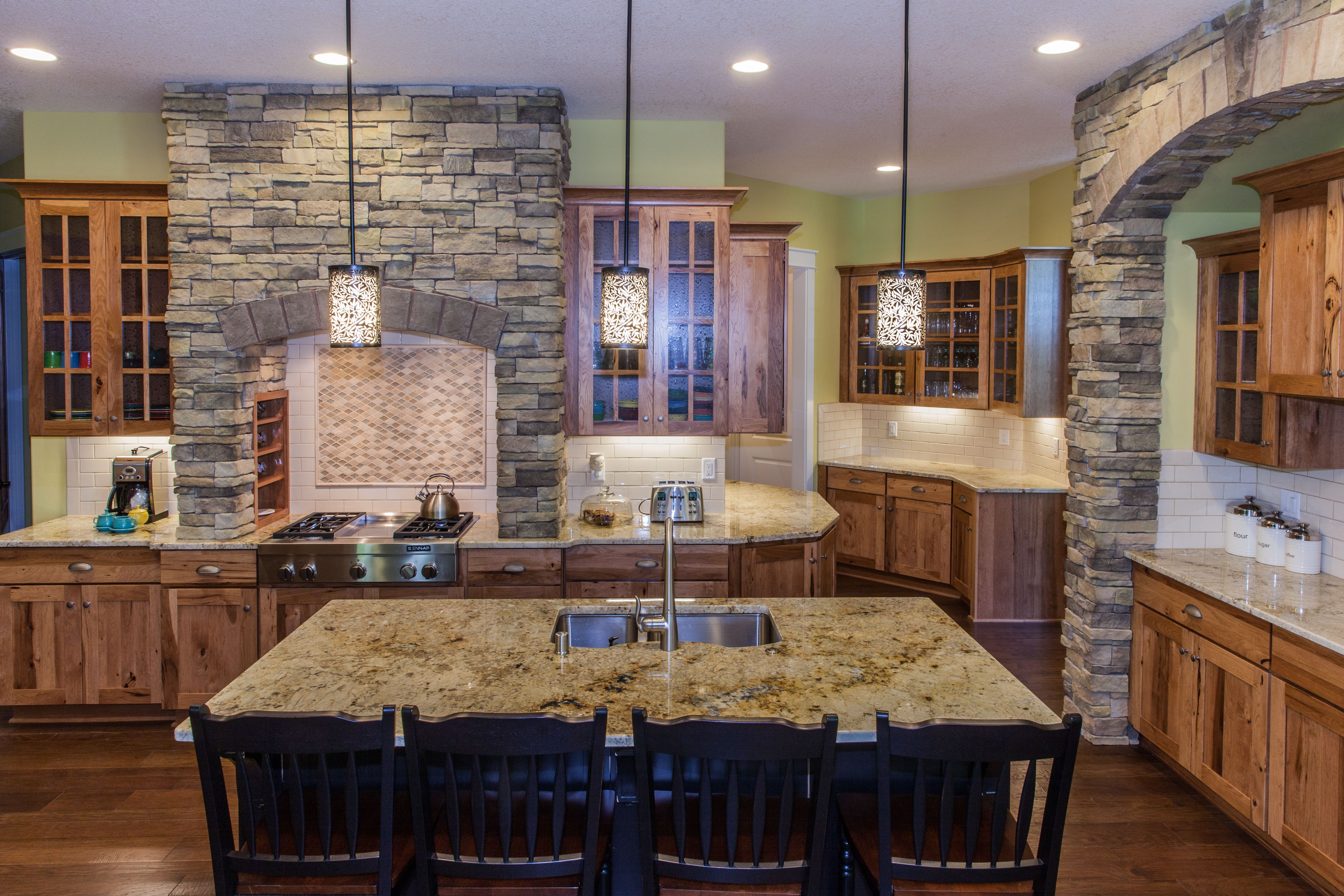 Kitchen with granite. Love this rock detailing! Home