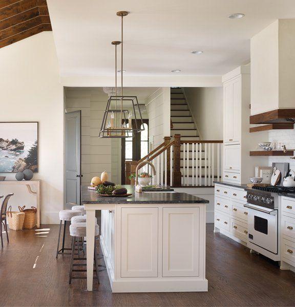 Modern Farmhouse Kitchen With Back Staircase Lantern Pendants Wood Trim And Shelving