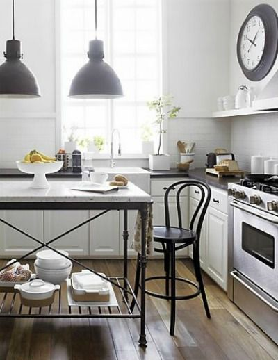 bentwood stool, pendants, iron and marble island, clock, shelving, subway tile