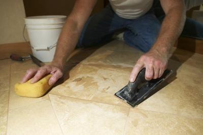 How To Waterproof Self Stick Tile Floors Hunker Groutable Vinyl Tile Tile Floor Ceramic Floor Tiles