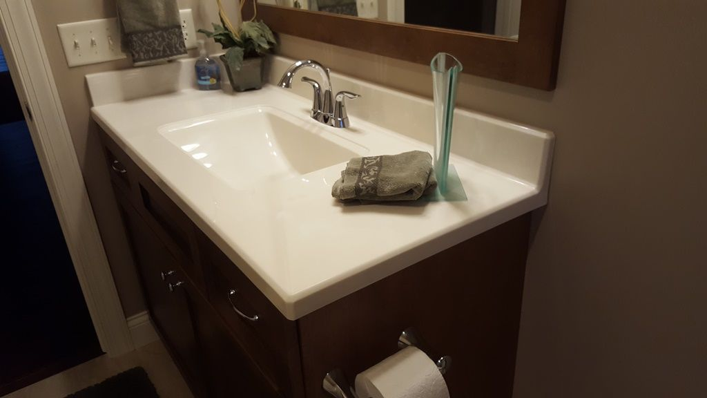 White On Biscuit Vanity Top With A Chamfer Edge Wave Bowl