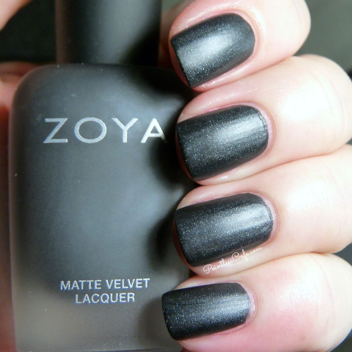 Zoya Dovima is a matte black polish with silver and a smattering of blue shimmer.