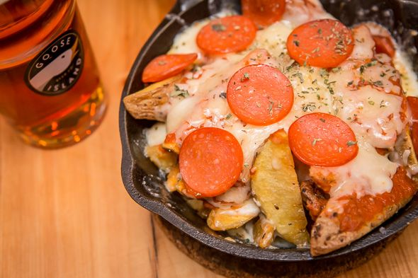 The menu at this new snack bar is ever changing, but can be counted on for $5 and $10 dishes. Highlights include sizzling skillets of pizza fries, and over-the-top desserts. Stop in for dinner and drinks most nights of the week from 6 p.m. or make it a destination for...