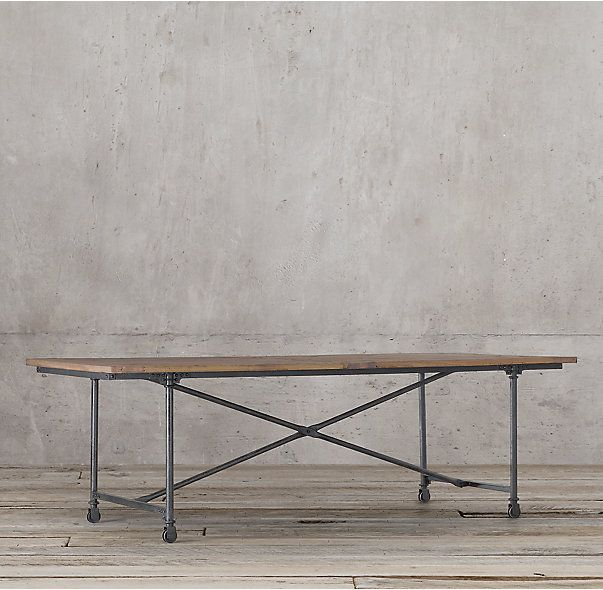 """RH's Flatiron Rectangular Dining Table:The pairing of antique solid reclaimed elm doors and cast metal achieves the """"form meets function"""" industrial appeal of Flatiron."""
