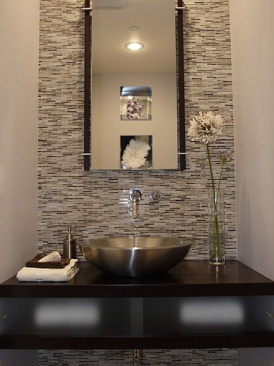 This Powder Room Features Glass Tile On The Wall A Stainless Steel Vessel Sink Modern Mounted Faucet Floating Counter Is Espresso Stained With