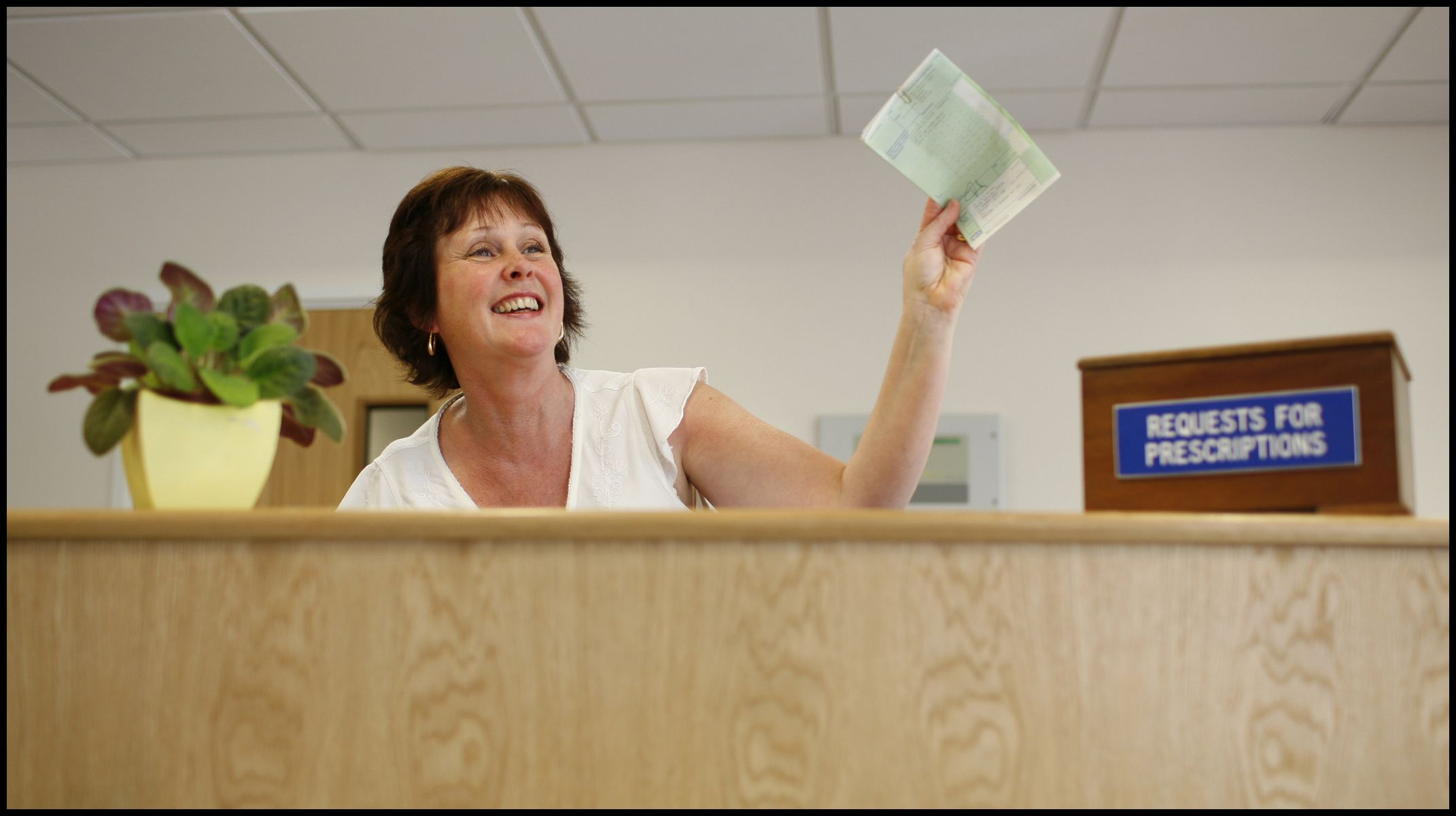 A receptionist at work at the Brune Medical Centre in