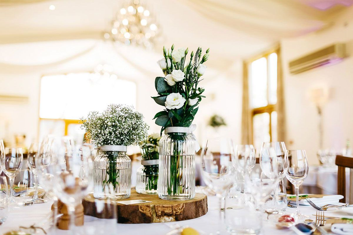 White and green floral wedding decorations in The Grain Store at ...