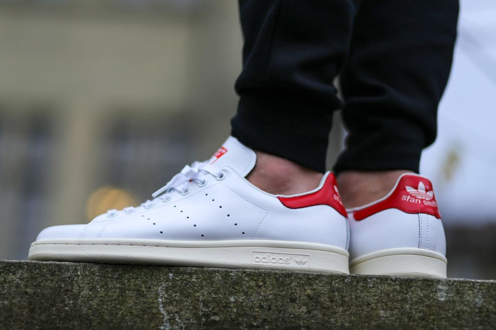 For its latest release, the Stan Smith is built on creamy white outsole  with a white leather upper that is accented with touches of red.
