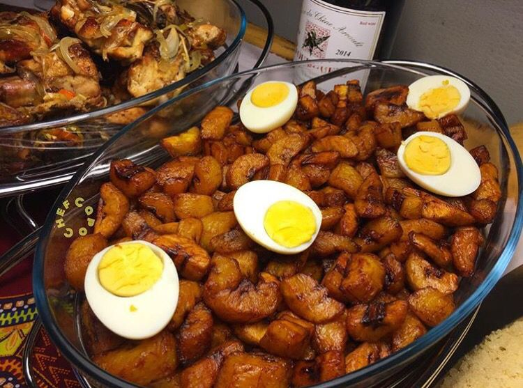 Alloco with bowled eggs and fried chicken west african