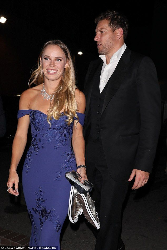 Beaming: Tennis pro Caroline Wozniacki and her NBA player beau David Lee certainly looked the vision of love as they headed to Serena Williams' wedding as she walked down the aisle with millionaire Reddit co-founder Alexis Ohanian in New Orleans