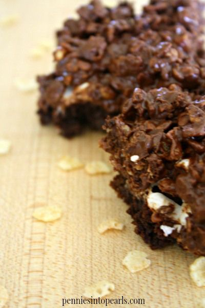 Triple Layered Crispy Brownie Recipe - penniesintopearls.com - Peanut butter, chocolate, toasted marshmallow over a perfect brownie are all keys to making this your new favorite recipe. You need this recipe!