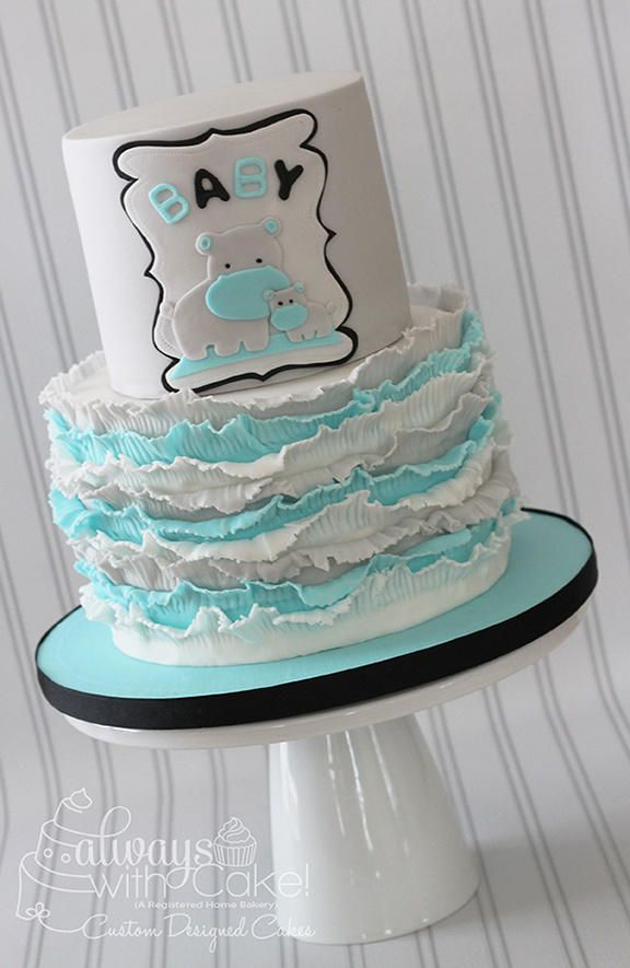 Ruffles made out of fondant. Hippos hand cut, to match clients baby shower inviations. Loved this color combo of white, grey and tiffany blue, with a touch of black.