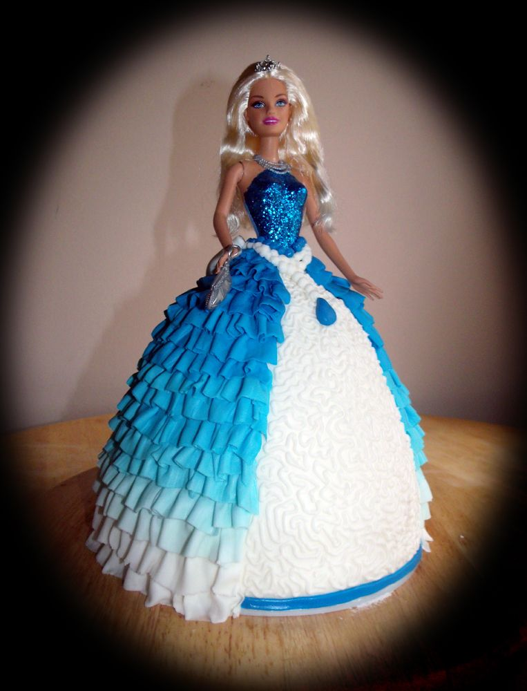 Blue Ruffled Barbie Princess Birthday Cake - Made this for my daughter's third birthday.  She picked the Barbie doll out herself, and then I made the edible skirt to match :-)  Four layers of moist vanilla cake filled and frosted with vanilla buttercream, and then covered and decorated with fondant.  This is one of my most favorite cakes I've ever done... it's the only cake I've ever done where I really didn't want to cut it :-)  I'm a Barbie girl at heart!!!