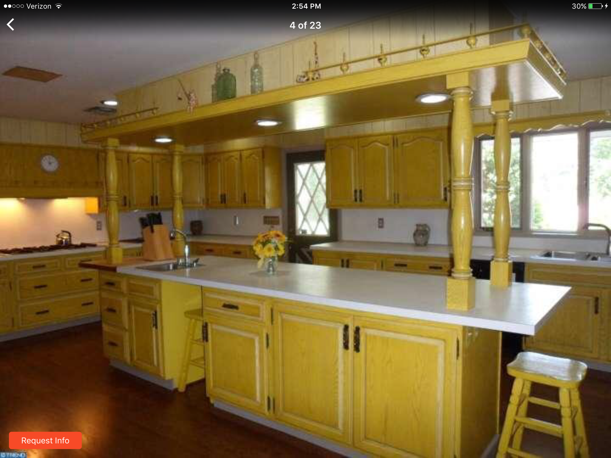Place cabinets and recessed lights above. Lose the columns ...