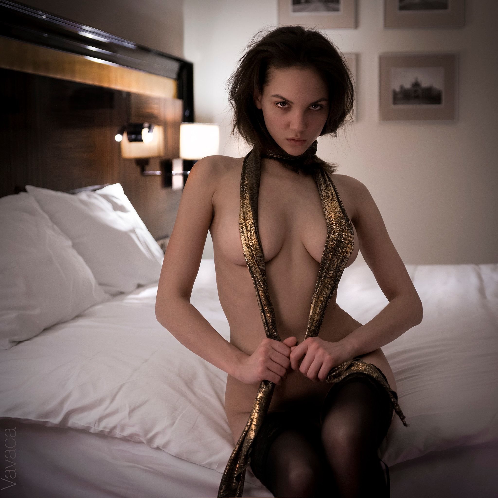 image Busty brunette in stockings gets dressed slowly