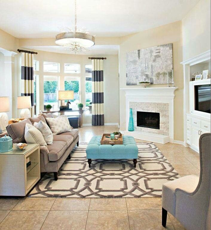 neutrals in large pieces and colors from curtains, rugs and accessories