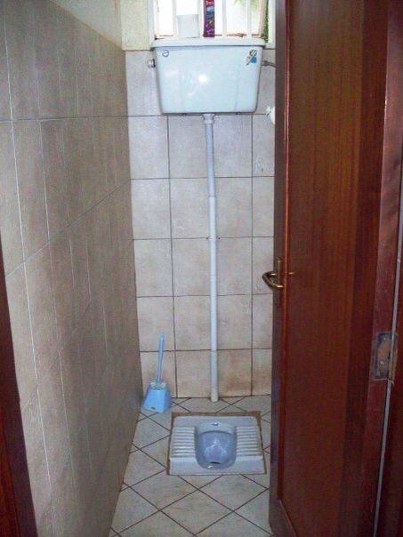 Bathroom with running water. Squats potty isn't quite what Americans are used to.