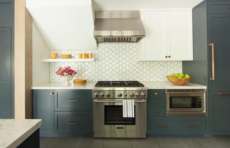 White And Blue Kitchen Boasts White Upper Cabinets And Dark Blue Lower Cabinets Adorned With Bras Kitchen Backsplash Trends Blue Kitchen Designs Kitchen Design