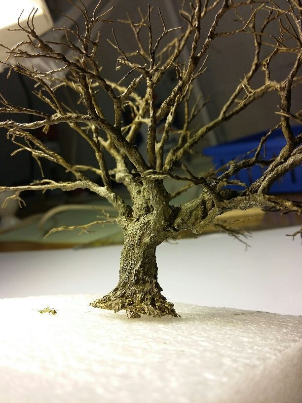 old oak made with wire, not sure of the what it's covered with...