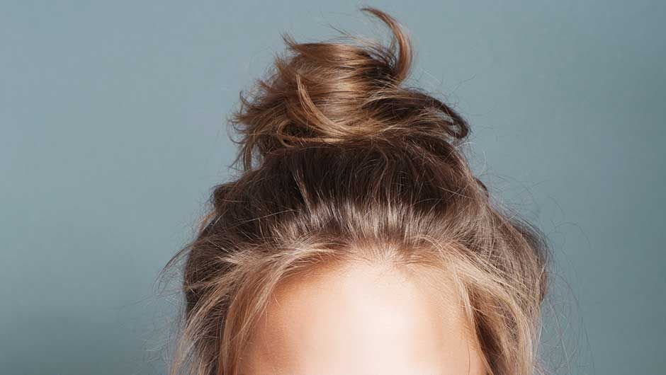 You Should Be Sleeping With Your Hair In A Bun Every Night Here S