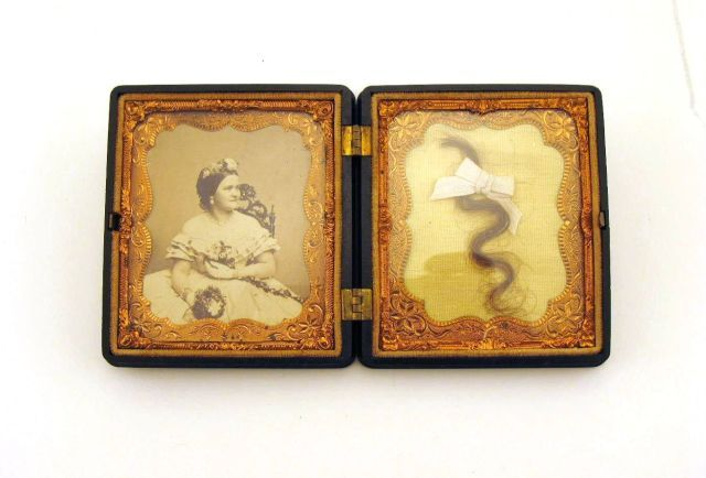 Mary Todd Lincoln's lock of hair and photograph encased in black gutta-percha daguerreotype case.