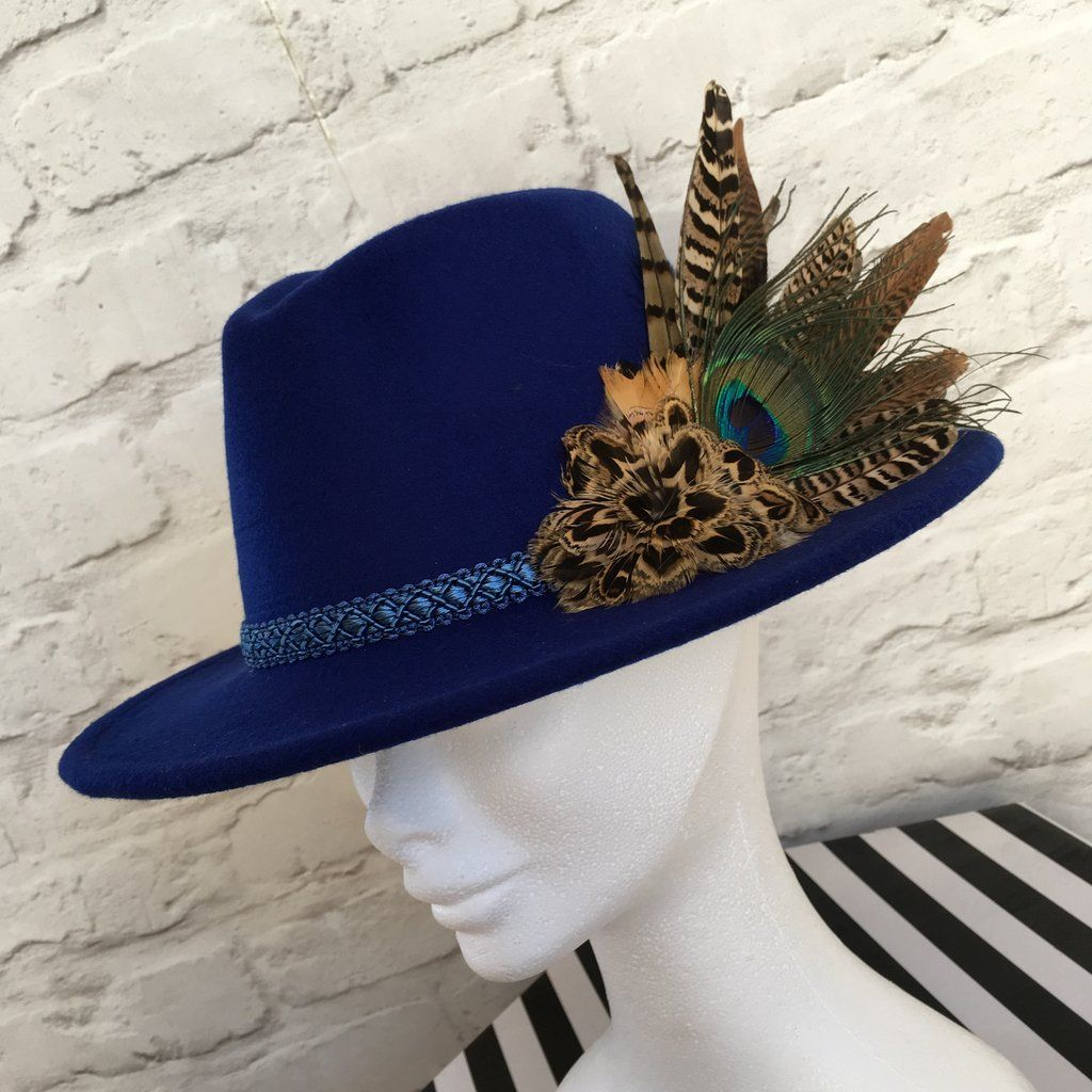 262c018c0cdfff Royal blue fedora embellished with natural game bird feathers in ...