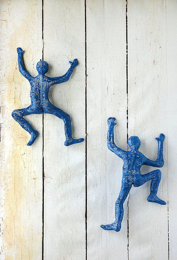 Man climbing wall mounted decor