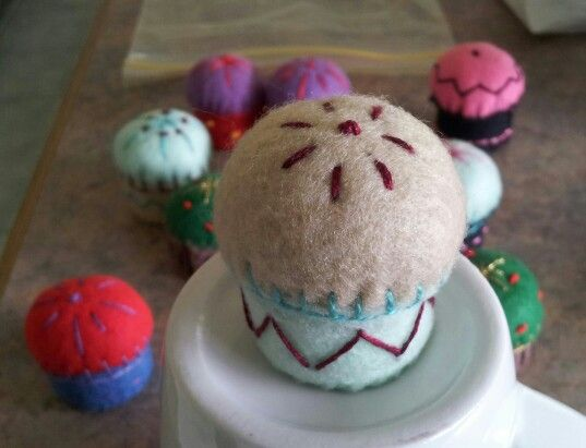 Mini Pin Cushion made with felt and a recycled bottle top.