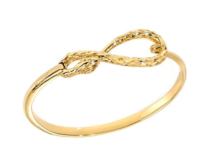 Seductive and alluring, the serpent has long been a source of inspiration for Just Cavalli's unique designs. This irresistible bangle features a crystal-studded winding serpent in the shape of the classic infinity symbol and is crafted in gold-plated stainless steel. Bracelet measures 7 1/4 inches in length.