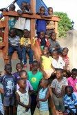 On their new swing set built by Promise Africa Mission Team 2011!