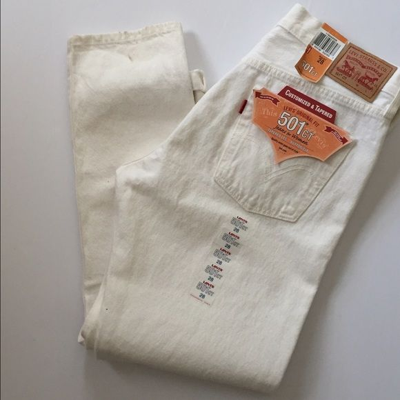 """Levi's 501 White Jeans 28 NEW NWT Levi's 501 jeans in size 28 (29"""" inseam). Button fly, tapered leg. New with tags. White. Has minor dusting marks at cuffs. Would almost certainly come out in wash.  no trades or low ball offers  Levi's Jeans Straight Leg"""