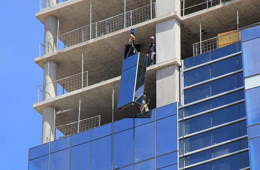 Exterior Curtain Wall System Workers Hoist Into Place