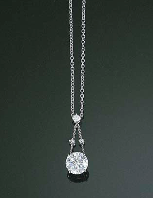 Avoid wasting time and money on poor jewelry decisions pinterest a diamond pendant necklace the circular cut diamond weighing 208 carats suspended from the diamond collet twin line surmount to an oval link neckchain mozeypictures Image collections