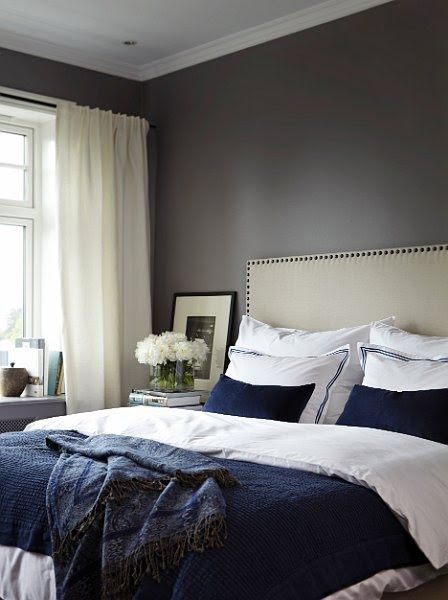 dark blue and white bed and dark walls.. white curtains.. possible ...