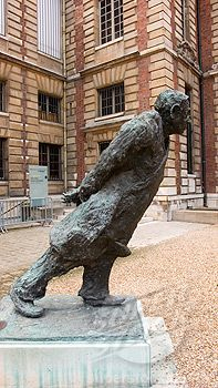 PARIS, FRANCE   l   Jean-Paul Sartre's statue leans into the courtyard at the Bibliotheque Nationale,