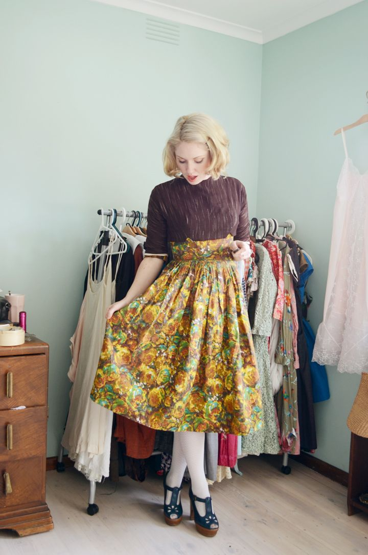 esme wearing a vintage dress with a vintage cropped jacket over it