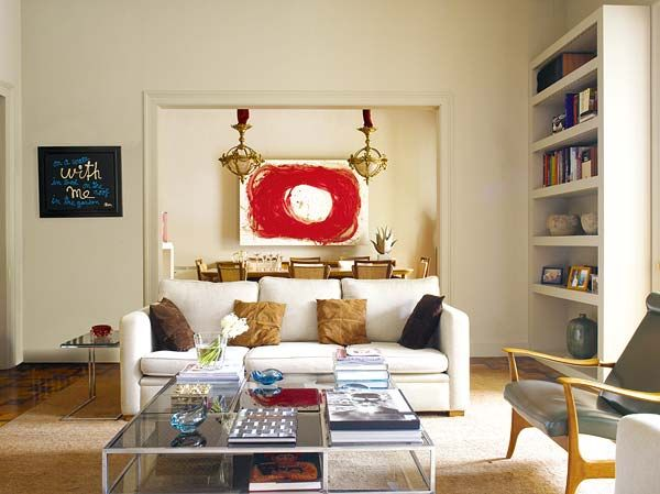 living-room-decorating-abstract-art-painting-red-white-coffee-table-decor-book-shelves-modern