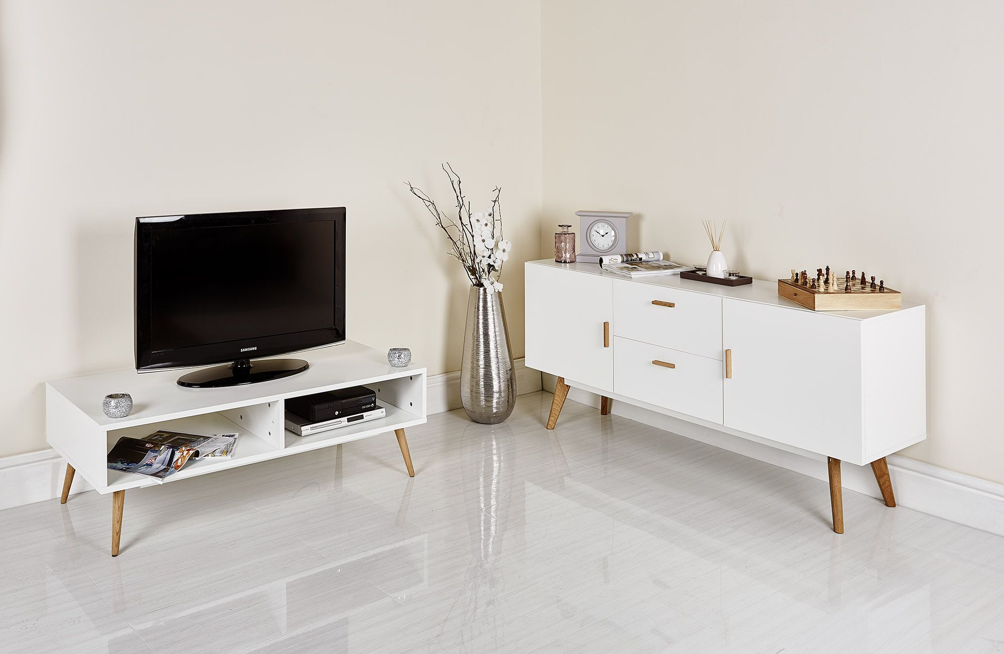 This two hole Scandinavian TV stand from Abreo takes TVs up to 55 ...