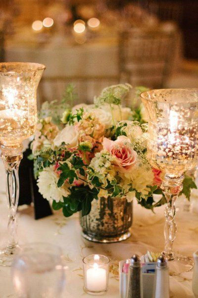 combination of pink, white and green makes a lavish statement, whether in a ceramic vase or shiny glass, and the candles within the tall textured stems are like poetry