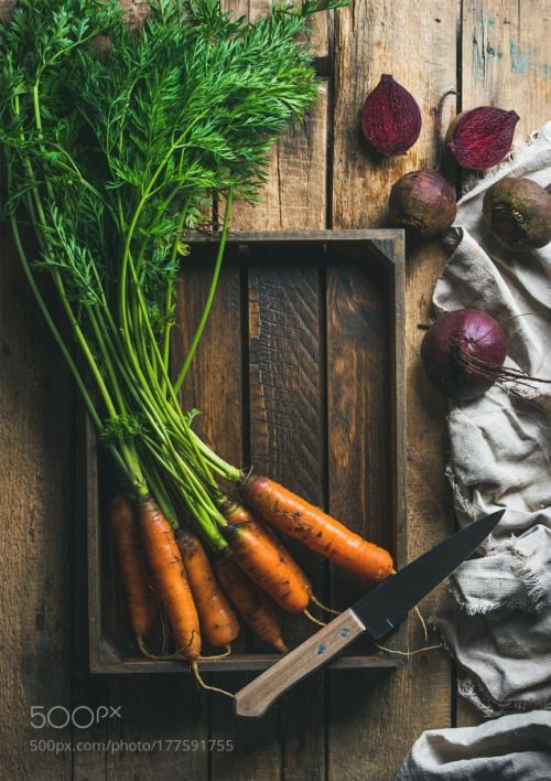 Garden carrots and beetroots in wooden tray over rustic background by 2enroute  IFTTT 500px